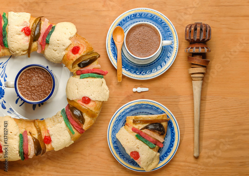 Epiphany cake, Kings cake, Rosca de reyes slice with  a cup of hot Chocolate and molinillo, top view