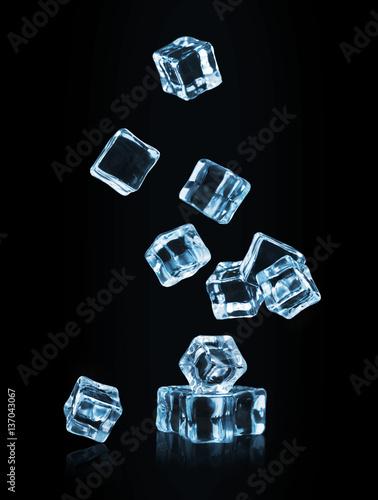 Photo  Ice cubes falling on black background
