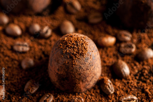Coffee beans and ground coffee with chocolate sweets