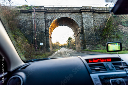Fotografía Car interior view of traveling below railroad bridge in UK