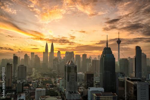 Photo Stands Kuala Lumpur Downtown Kuala Lumpur skyline at twilight