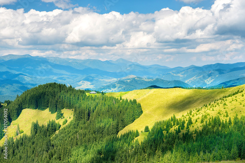 Foto auf Gartenposter Hugel Green sunny valley in mountains