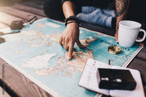 Tourist exploring the world map.