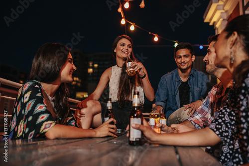 Fototapeta Friends enjoying party with drinks obraz na płótnie