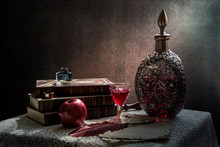 Set Of Vintage Objects. Still Life With  Vintage Wine Decanter And  Glass Of Wine, Old Books,  Old  Vintage Paper,  Feather And Ink