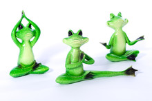 Group Of Green Frog Figures Stretching And Doing Yoga Exercises