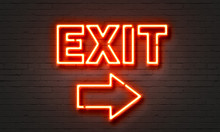 Exit Neon Sign On Brick Wall Background.