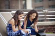 Girls (10-11) watching movies on tablet pc