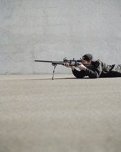 Man Aiming High Powered Rifle,...
