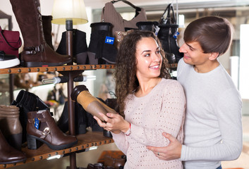 Young couple in a shoe store.
