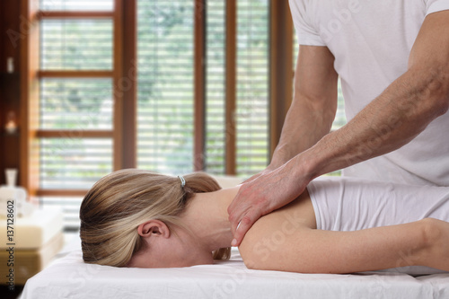 Young woman having massage Canvas Print