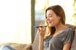 Leinwandbild Motiv Girl using a smart phone voice recognition