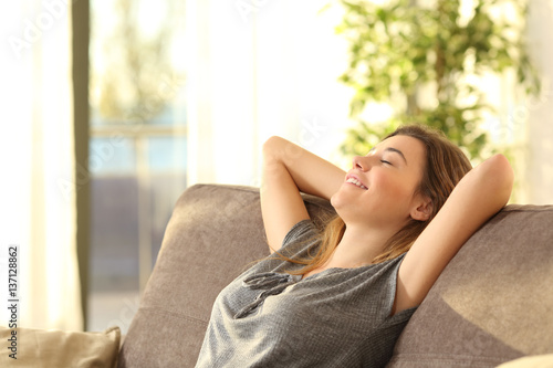 Poster Relaxation Girl relaxing on a sofa at home