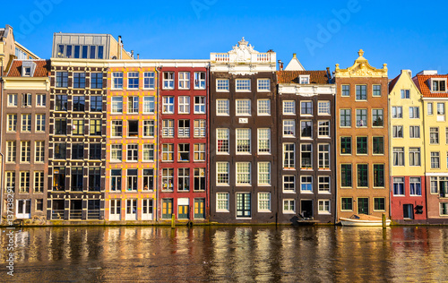 Traditional old buildings and boats in Amsterdam, Netherlands Canvas Print