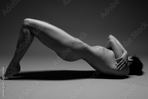 beautiful nude woman practicing yoga плакат