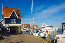 Traditional Houses And Small Vessels In Holland Town Volendam, Netherlands