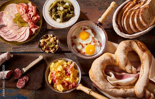 Fototapeta Fresh homemade bread sliced and served with eggs obraz
