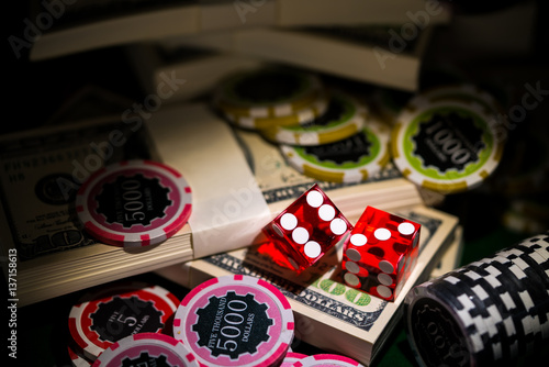 Valokuva  Red dices on chip and dollar bills, casino concept