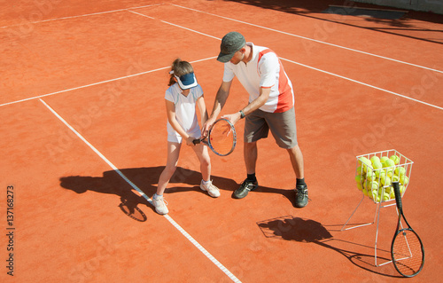 Tennis coach with talented young girl