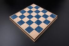 Chessboard On A Black Backgrou...