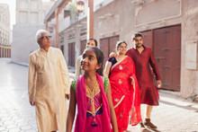 Family Walking On Street At Bur Dubai.