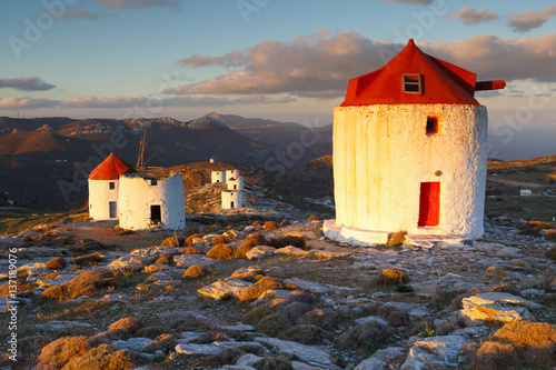 Windmills over  Chora of Amorgos island early in the morning. Canvas Print