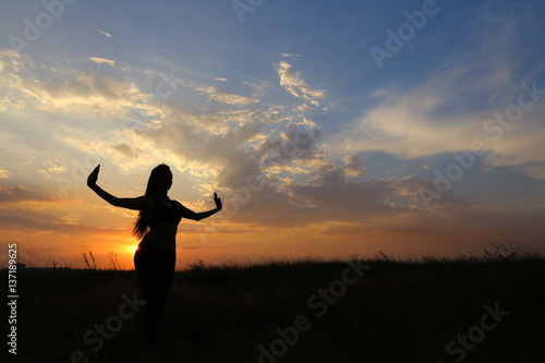 Garden Poster Martial arts Slim girl showing various poses and dancing in a field outdoors