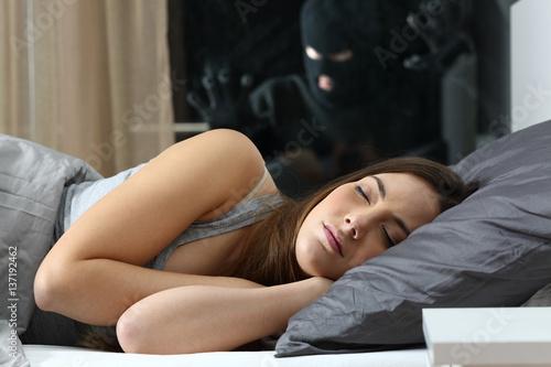 Cuadros en Lienzo  Woman sleeping with an intruder watching