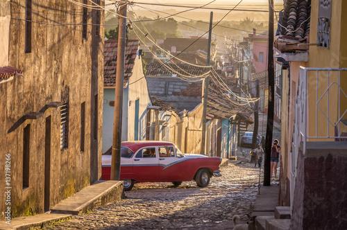 Cuban street with oldtimer in Trinidad, Cuba Fototapeta