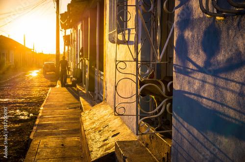 Fotografija  Cuban street with oldtimer at sunset in Trinidad, Cuba
