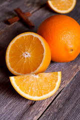 Orange fruit on wooden table background
