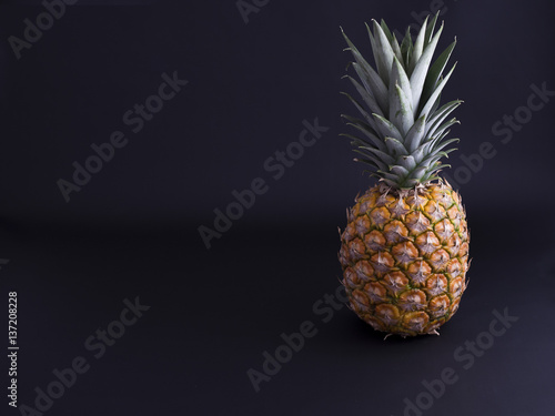 Fototapety, obrazy: Pineapple isolated on black background