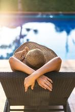 Women Relaxing Near Luxury Swi...