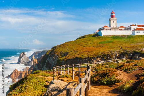 Foto auf AluDibond The lighthouse in Cabo da Roca. Cliffs and rocks on the Atlantic ocean coast in Sintra in a beautiful summer day, Portugal