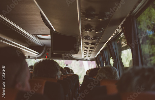 View from inside the bus with passengers.