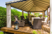 Gazebo On Wooden Deck Furnished With Wicker Furniture, Quebec, Canada
