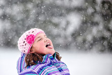 Girl Catching Snowflake On Her...