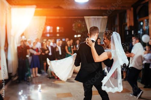 Obraz Happy bride and groom a their first dance, wedding - fototapety do salonu