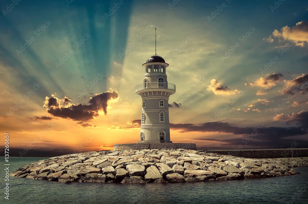 Fototapeta Lighthouse on the sea under sky.