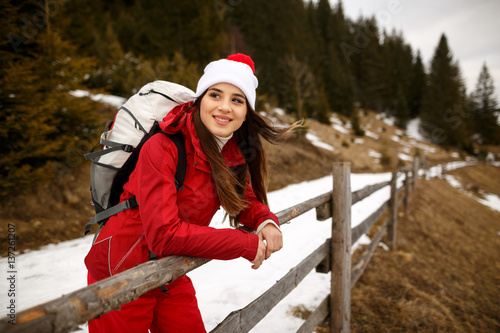 Fototapeta Young woman hiking in winter mountains. Happy smiley girl obraz na płótnie