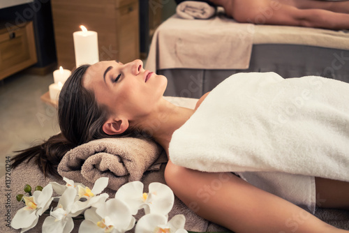 Fototapety, obrazy: Man and woman lying down on massage beds at Asian wellness center