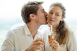 Happy man kissing his girlfriend at romantic date