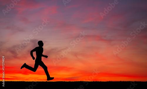 Deurstickers Vechtsport Silhouette of running man on sunset fiery sky background