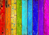 Fototapeta Tęcza - colorful vibrant rainbow wooden planks background texture pattern / holz hintergrund bunt regenbogen farbenfroh vorlage textur