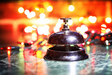 Reception Bell On Table And Co...