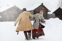 Young Girls In Traditional Costumes Of The Russian North In Winter