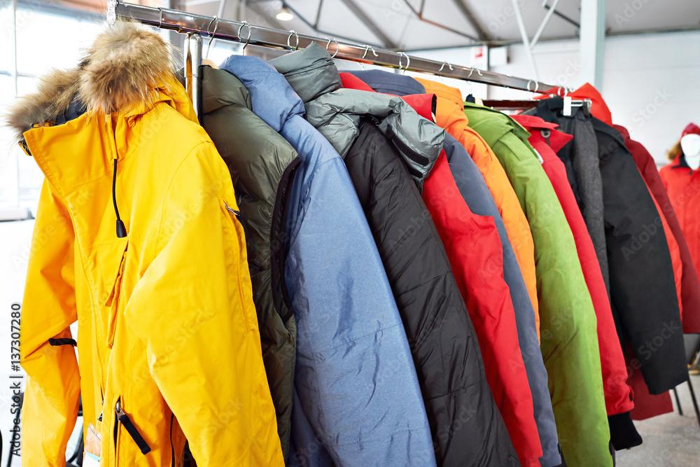 Fototapeta Winter ski sports jacket on hanger in  store