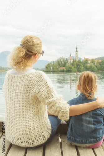 Fotografie, Obraz  Mother and daughter enjoying the view on a lake.