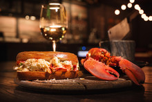 Lobster And Lobster Sandwich Served With Wine. Seafood Dinner In A Restaurant
