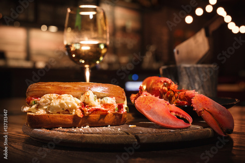 Obraz na płótnie Lobster and lobster sandwich served with wine